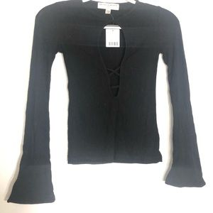 Long sleeve black top with opening in front